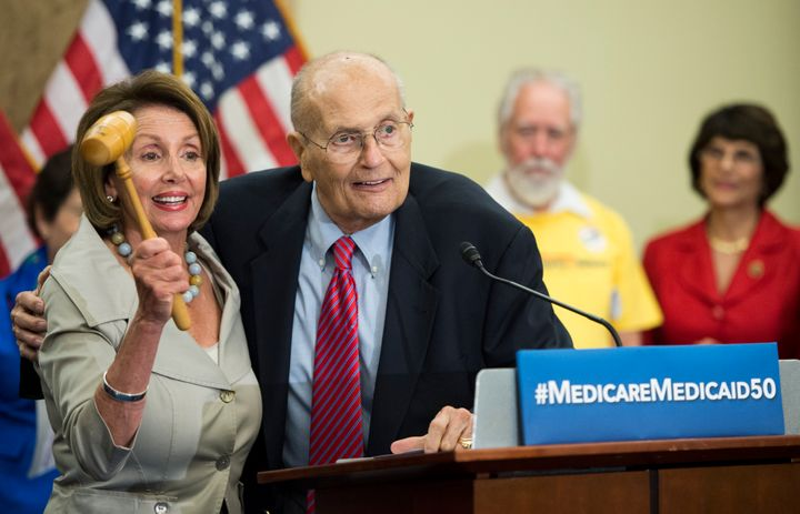 House Minority Leader Nancy Pelosi (D-Calif.) and former Rep. John Dingell celebrate the 50th anniversary of Medicare and Med