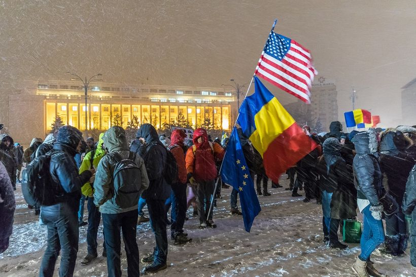 Protesters gather in front of the government building in Victory Square, Bucharest, Romania.