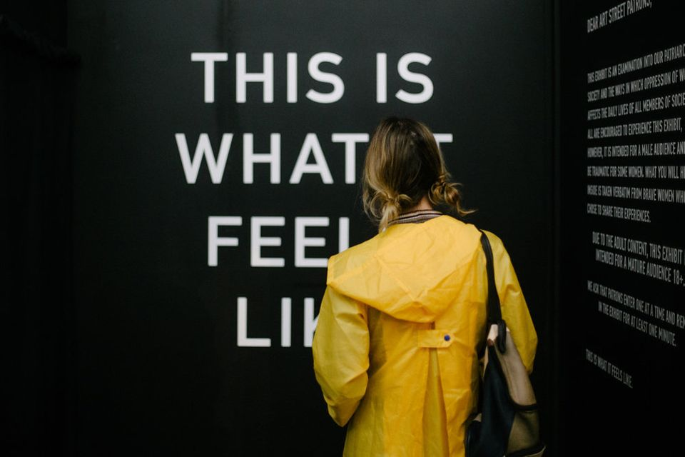 A woman attends the exhibit in Sacramento,