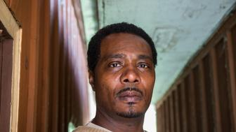 Keith Cooper, 47, poses for a portrait at his home on April 29, 2014 in Country Club Hills, Ill. Cooper has petitioned Indiana Gov. Mike Pence to pardon him for a robbery he insists he did not commit. (Zbigniew Bzdak/Chicago Tribune/TNS via Getty Images)