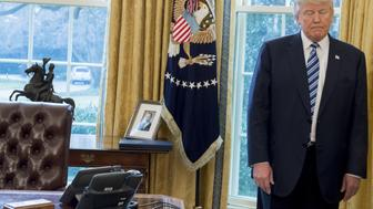 US President Donald Trump stands behind his desk after Jeff Sessions was sworn in as Attorney General in the Oval Office of the White House in Washington, DC, February 9, 2017. / AFP / SAUL LOEB        (Photo credit should read SAUL LOEB/AFP/Getty Images)