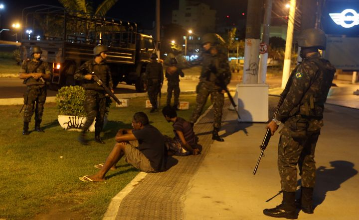 Army officers detain two men in Vitoria.
