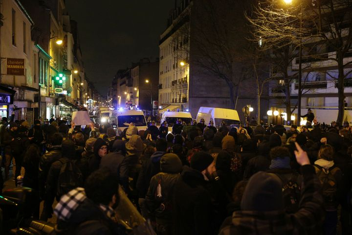 Police block a street as people gather to protest against an alleged police assault on a black man in central Paris, Feb. 8,
