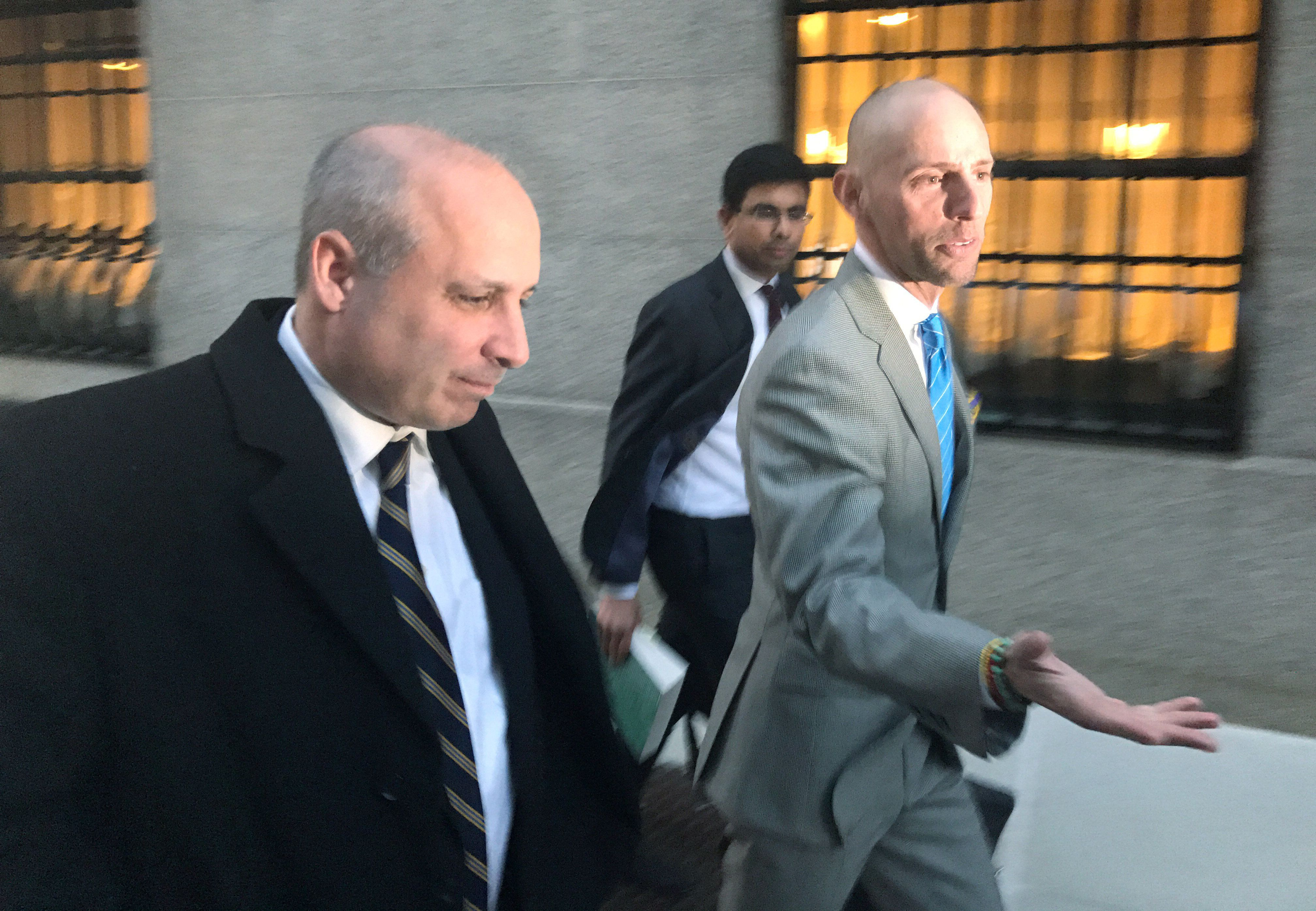 David Polos (L), a former assistant special agent-in-charge at the U.S. Drug Enforcement Administration, exits the federal court with his lawyer, Marc Mukasey (R), in Manhattan, New York, U.S., February 8, 2017.  REUTERS/Nate Raymond