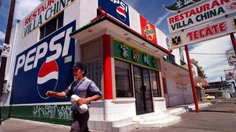 TR.Mexicali.VillaChina.0727.AJBA painted Pepsi sign covers the southside wall of the Villa China Chinese restaurant in Mexicali, Mexico.  (Photo by Aurelio Jose Barrera/Los Angeles Times via Getty Images)