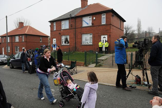 Police officers guard the home of Shannon and Karen Matthews during the search for the nine-year-old...