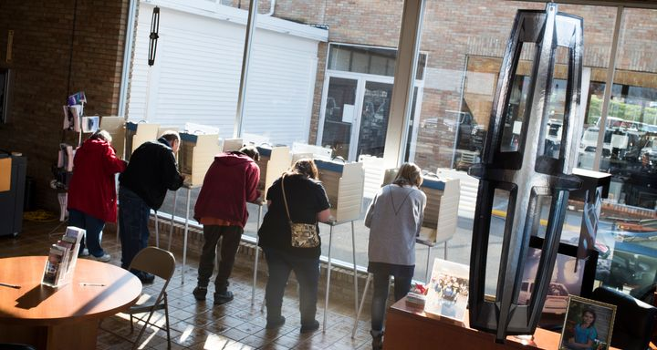 Voters cast their ballots at the Donnell Ford car dealership on November 8, 2016 in Salem, Ohio.