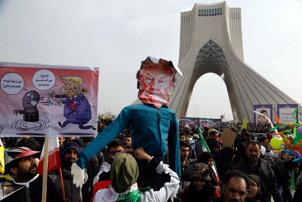 Iranians hold a dummy representing U.S. President Donald Trump during a rally marking the anniversary of the 1979 Islamic Rev