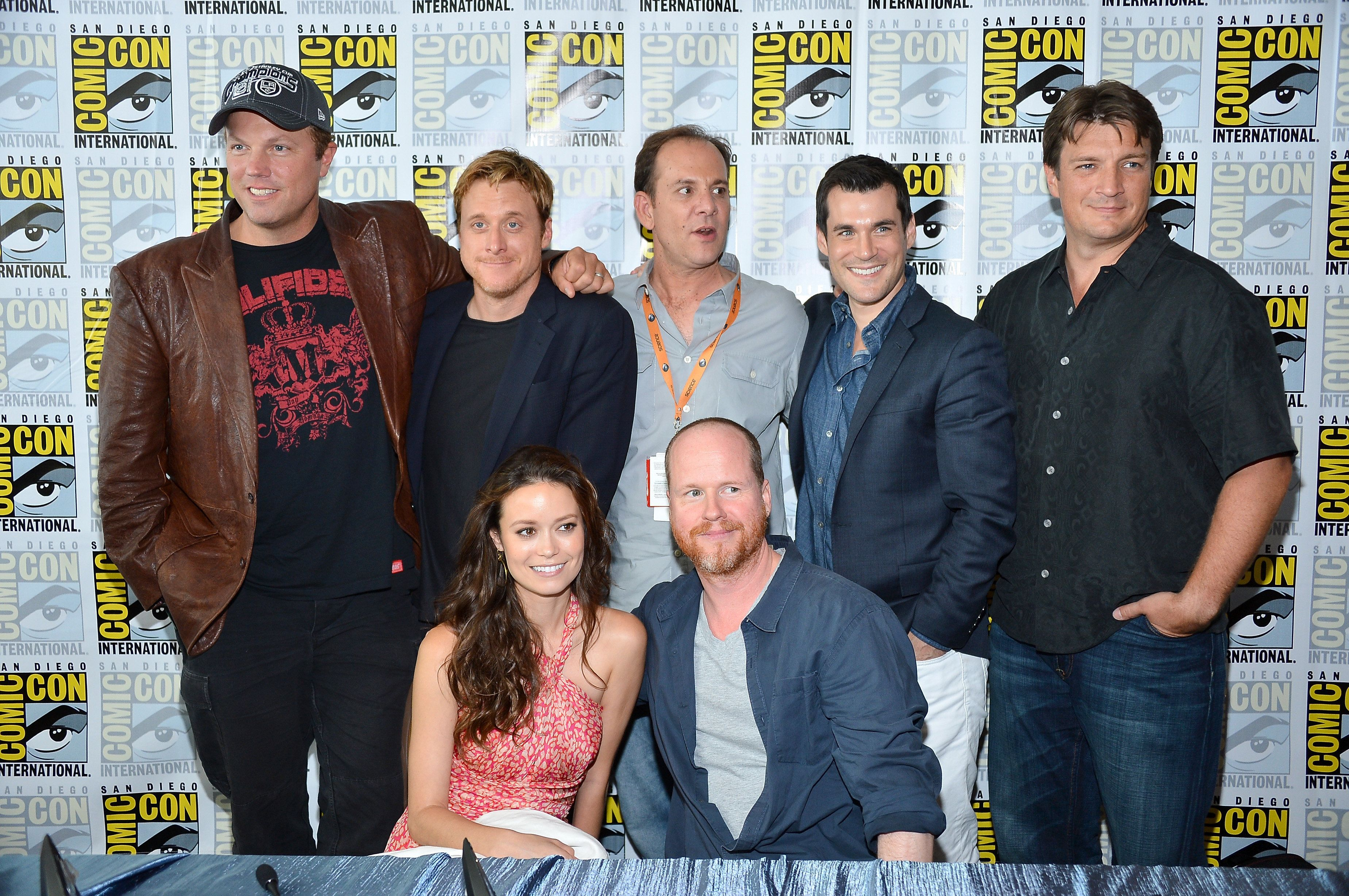 SAN DIEGO, CA - JULY 13:  The Cast of Firefly (Standing L-R) Adam Baldwin, Alan Tudyk Tim Minear. Sean Maher, Nathan Fillion, (Kneeling) Summer Glau and Joss Whedon at the 'Firefly' 10 Year Anniversary Reunion Press Conference during Comic-Con International 2012 held at the Hilton San Diego Bayfront Hotel on July 13, 2012 in San Diego, California.  (Photo by Frazer Harrison/Getty Images)