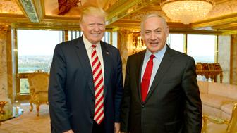 FILE PHOTO: Israeli Prime Minister Benjamin Netanyahu (R) stands next to Republican U.S. presidential candidate Donald Trump during their meeting in New York, September 25, 2016.      Kobi Gideon/Government Press Office (GPO)/Handout via REUTERS/File Photo         ATTENTION EDITORS - THIS IMAGE HAS BEEN SUPPLIED BY A THIRD PARTY. FOR EDITORIAL USE ONLY.