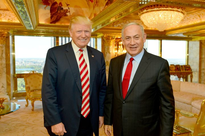 Israeli Prime Minister Benjamin Netanyahu (R) stands next to then-candidate Donald Trump during their meeting in New York, Se