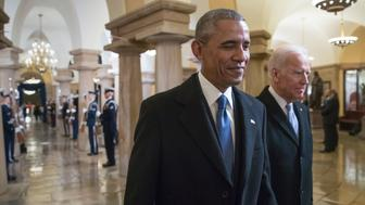 US President Barack Obama and Vice President Joe Biden walk through the Crypt of the Capitol for Donald Trump's inauguration ceremony, in Washington, DC, on January 20, 2017.  / AFP / POOL / J. Scott Applewhite        (Photo credit should read J. SCOTT APPLEWHITE/AFP/Getty Images)