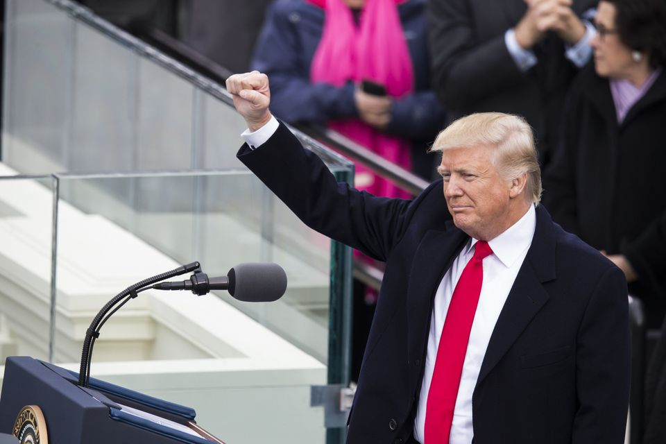 President Donald Trump raises his fist to the crowds during his inauguration after he was sworn in as the 45th president&nbsp