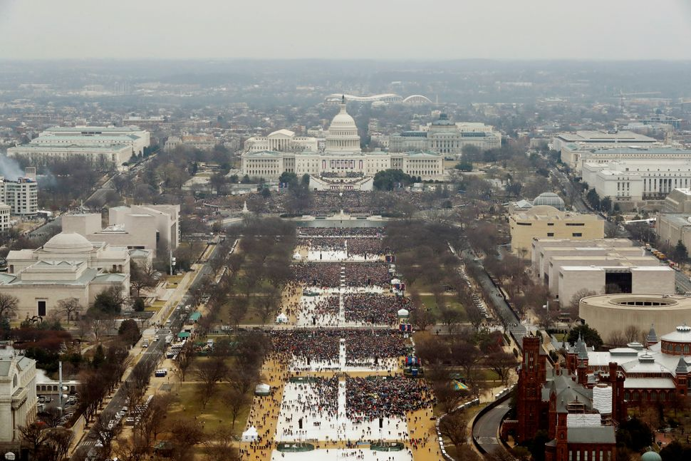 Attendees line the Mall as they watch ceremonies to swear in Trump on Inauguration Day.