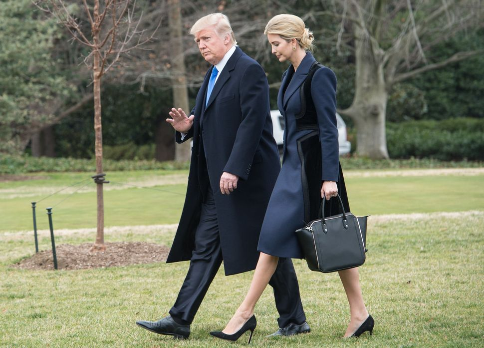 Trump and his daughter Ivanka walk to board Marine One at the White House on Feb. 1, 2017.
