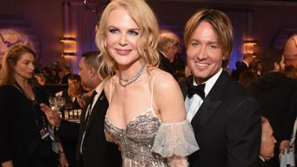 BEVERLY HILLS, CA - JANUARY 08:  Actress Nicole Kidman (L) and musician Keith Urban attend the 74th Annual Golden Globe Awards at The Beverly Hilton Hotel on January 8, 2017 in Beverly Hills, California.  (Photo by Michael Kovac/Getty Images for Moet & Chandon )