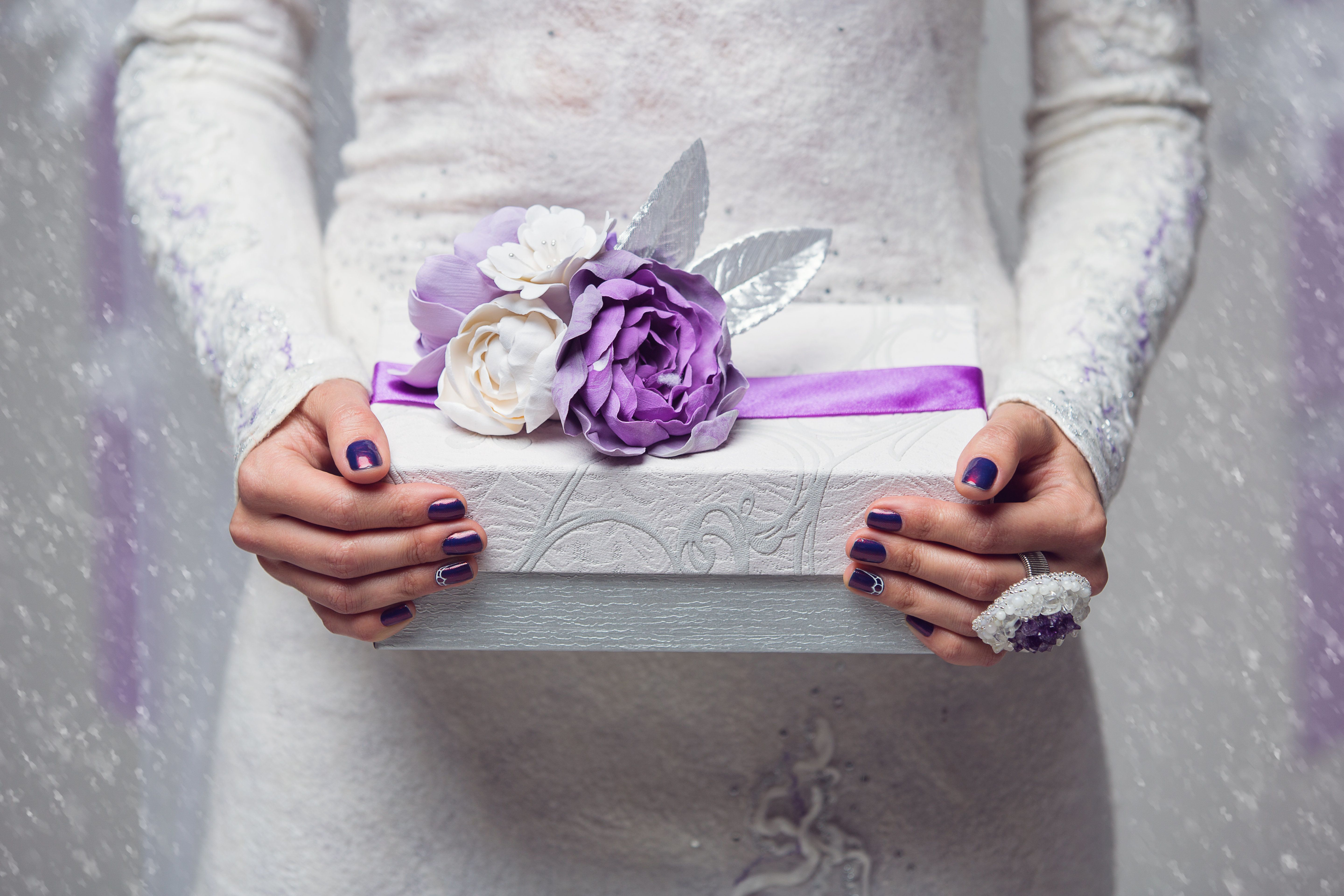 Violet present or gift box with a flowers and a lilac ribbon