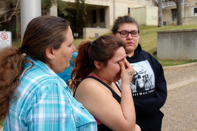 Angel Velazquez wipes tears from her eyes after exiting the courthouse in downtown Austin, Texas. Her...
