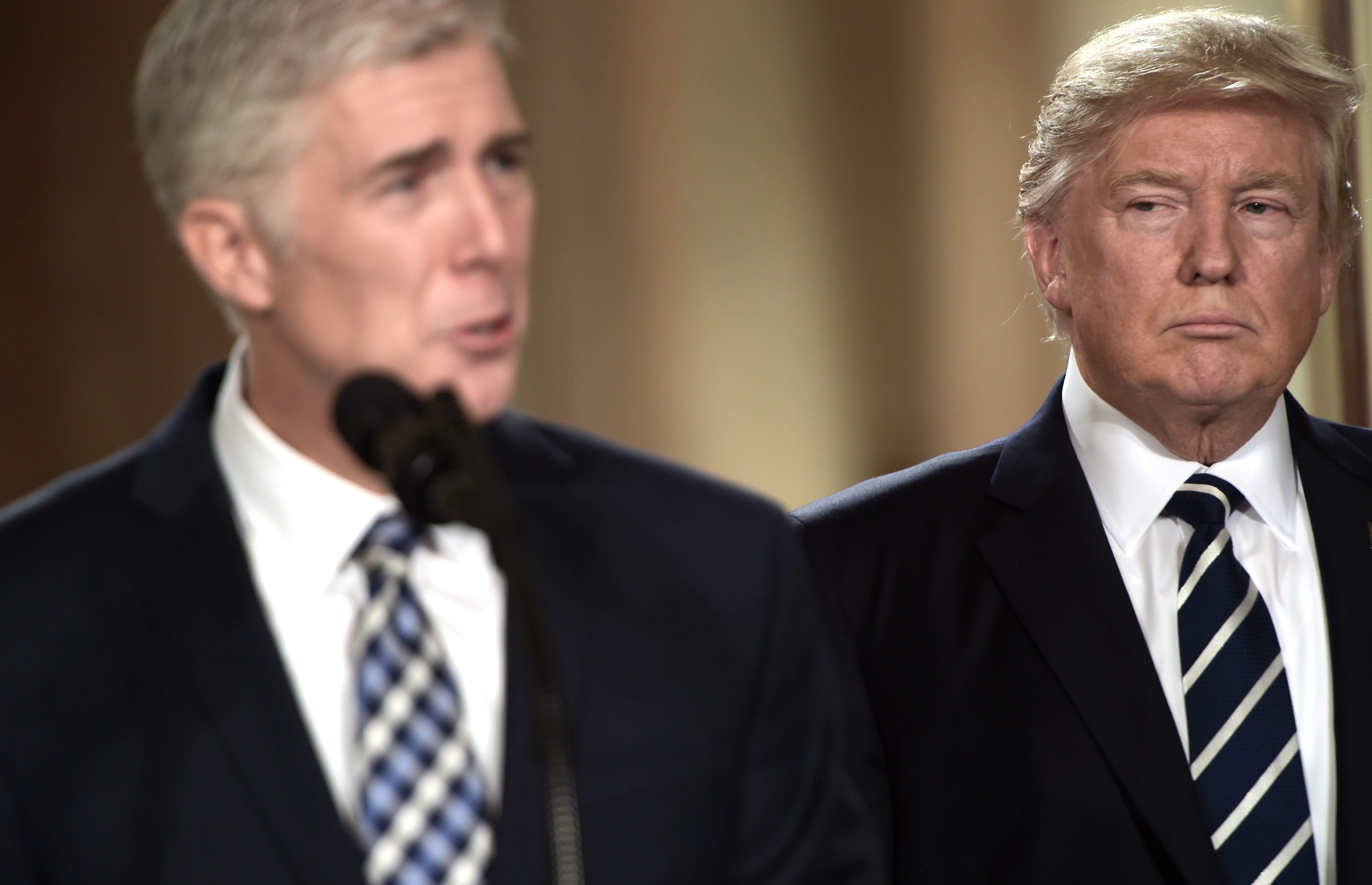 Judge Neil Gorsuch (L) speaks, after US President Donald Trump nominated him for the Supreme Court, at the White House in Washington, DC, on January 31, 2017. President Donald Trump on nominated federal appellate judge Neil Gorsuch as his Supreme Court nominee, tilting the balance of the court back in the conservatives' favor. / AFP / Brendan SMIALOWSKI        (Photo credit should read BRENDAN SMIALOWSKI/AFP/Getty Images)