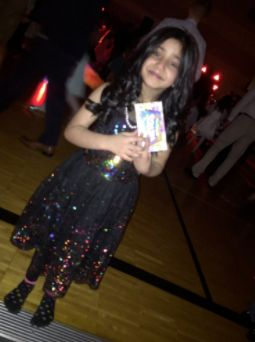 Noor shows off her prize … and matching socks.