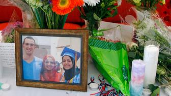 A makeshift memorial was built at the UNC School of Dentistry in the wake of the murder of Deah Shaddy Barakat, 23, and his wife Yusor Abu-Salha, 21, and Abu-Salha's sister, Razan Abu-Salha, 19 on Wednesday, Feb. 11, 2015 in Chapel Hill, N.C.   Their neighbor, Craig Stephen Hicks, 46, is being held on three counts of first-degree murder.  Deah was a second year dental student. (Chris Seward/News & Observer/TS)