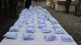 Police in Badakhshan province,  northeast of Afghanistan, on November 7, 2016, a shipment of heroin with two drug traffickers arrested. Badakhshan in northeast Afghanistan is a border region province and this province has a long border with Tajikistan through this border drug smugglers trying to smuggle narcotic to Central Asian countries.  (Photo by Mohammad Sharif Shayeq/NurPhoto via Getty Images)
