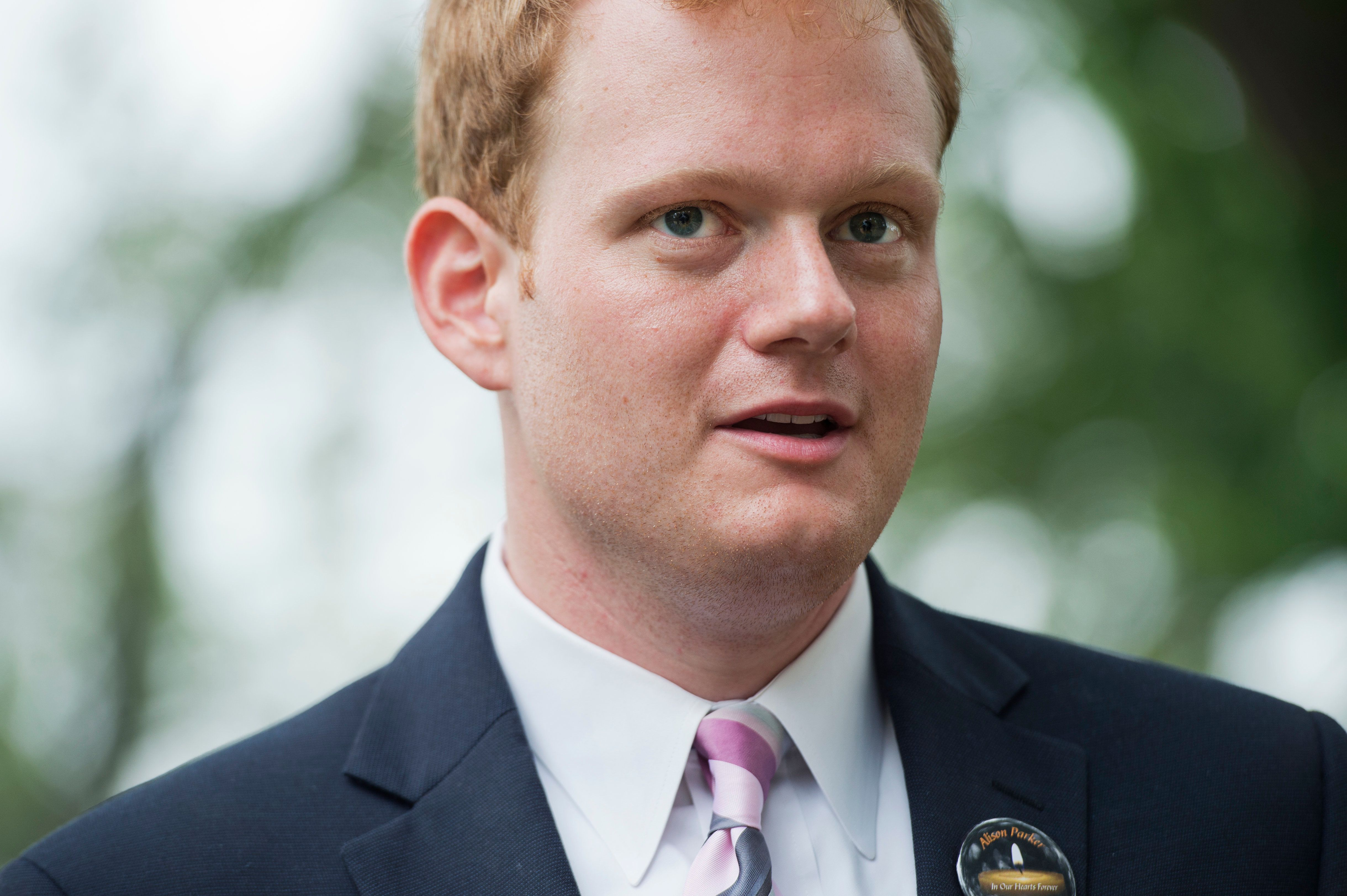 UNITED STATES - SEPTEMBER 10: Chris Hurst, whose girlfriend Alison Parker, a reporter for WDBJ-TV reporter, was killed on air last month, greets Gov. Terry McAuliffe, D-Va., during a rally on the East Front lawn of the Capitol to demand that Congress take action on gun control legislation, September 10, 2015. The event, titled #Whateverittakes Day of Action, was hosted by Everytown for Gun Safety and featured speeches by political leaders and families of gun violence victims. (Photo By Tom Williams/CQ Roll Call)