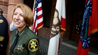Santa Ana, California–June 24, 2008 Sandra Hutchens smiles after being sworn in as the Orange County's new sheriff on the court steps of the Old County Courthouse Tuesday.  (Photo by Wally Skalij/Los Angeles Times via Getty Images)
