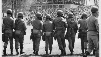 View, from behind, of members of the Ohio National Guard, with gas masks and fixed bayonettes, as they advance towards Blanket Hill to disperse antiwar demonstrators and students at Kent State University, Kent, Ohio, May 4, 1970. Four protestors were eventually shot and killed (and nine injured) when troops began to fire their weapons into the crowd. (Photo by Howard Ruffner/Getty Images)