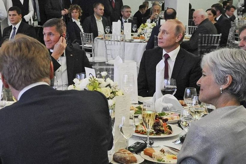 Trump's national security adviser, Michael Flynn, at an RT party with Russian president Vladimir Putin.