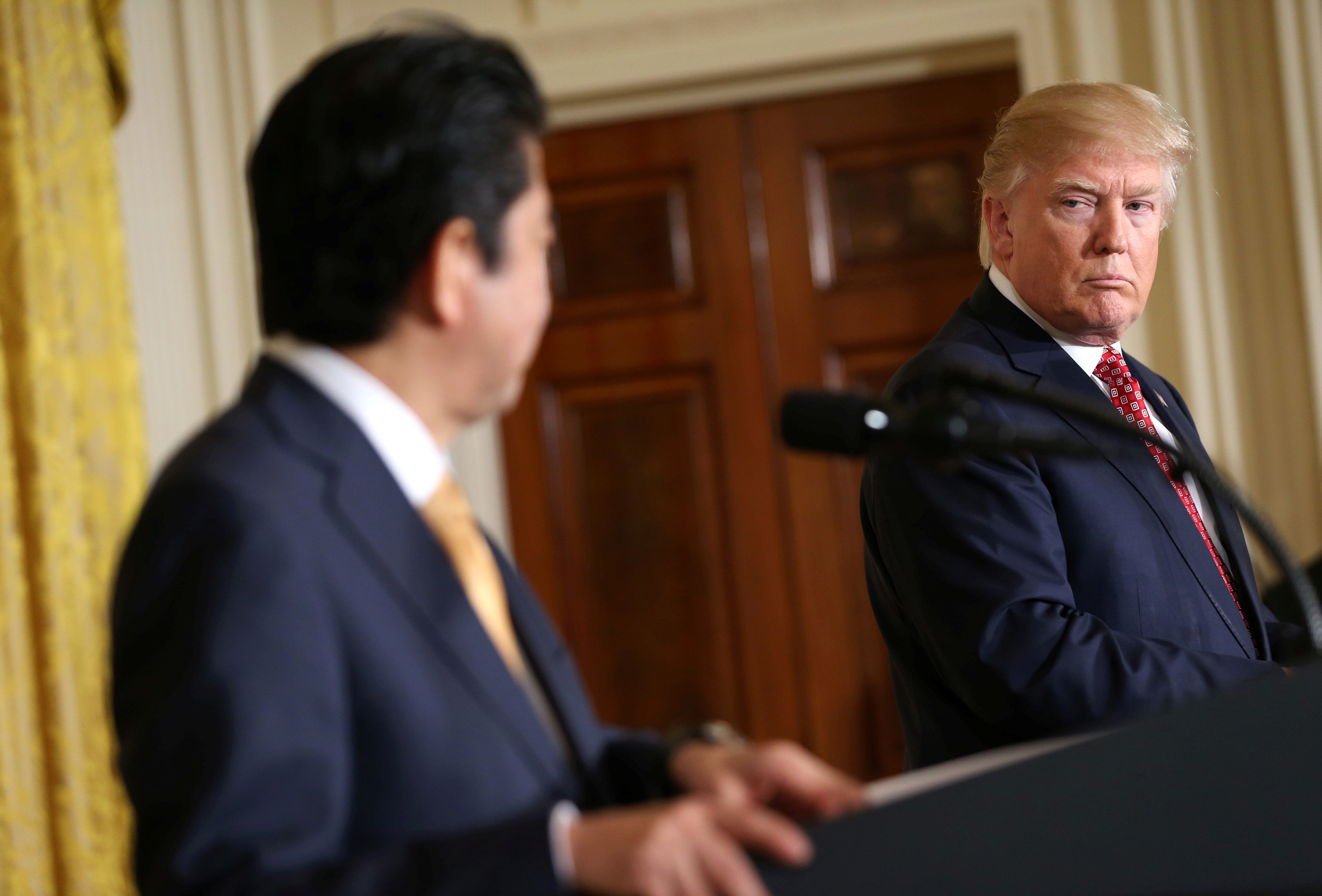 U.S. President Donald Trump and Japanese Prime Minister Shinzo Abe take part during a joint news conference at the White House in Washington, U.S., February 10, 2017.     REUTERS/Joshua Roberts