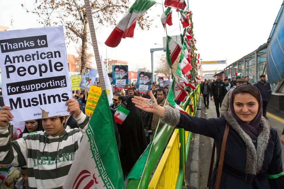 Iranians in Tehran celebrate the anniversary of the 1979 Islamic Revolution by thanking Americans for protesting Trump's trav