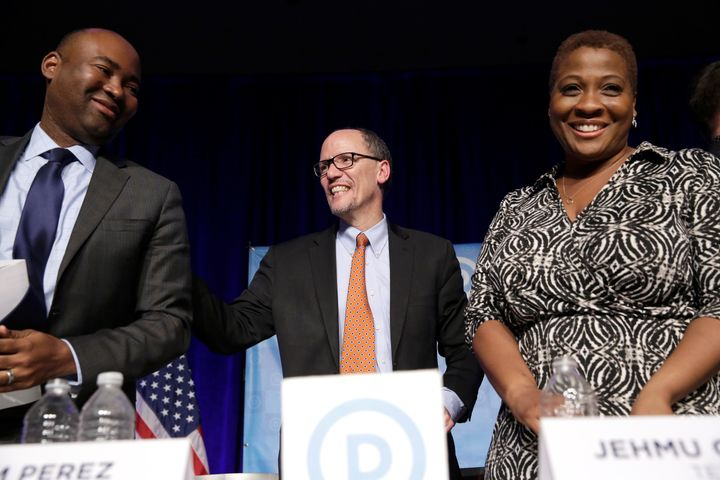Former Secretary of Labor Tom Perez (center) speaks to Jaime Harrison (L) and Jehmu Greene during a forum in Baltimore, Maryland, on Feb. 11, 2017.