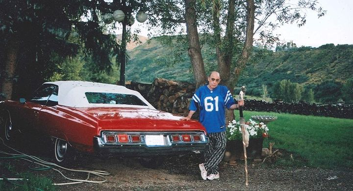 Hunter Thompson in his Colts jersey with the Red Shark at Owl Farm, 2003