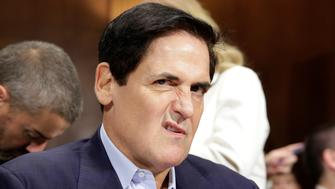Chairman of AXS TV and owner of the Dallas Mavericks Mark Cuban jokingly makes a face before the Senate Judiciary Committee Antitrust Subcommittee hearing on the proposed deal between AT&T and Time Warner in Washington, U.S., December 7, 2016. REUTERS/Joshua Roberts