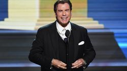 John Travolta Dances With 50 Cent In Cannes And It Is A Sight To
