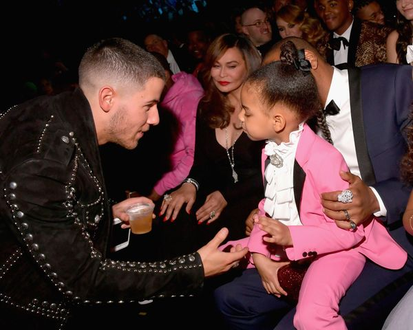 Singer-songwriter Nick Jonas (L) and Blue Ivy Carter during The 59th GRAMMY Awards at STAPLES Center on Feb. 12, 2017 in Los