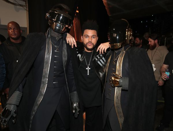 Musicians Daft Punk and The Weeknd (C) attend The 59th GRAMMY Awards at STAPLES Center on Feb. 12, 2017 in Los Angeles, Calif