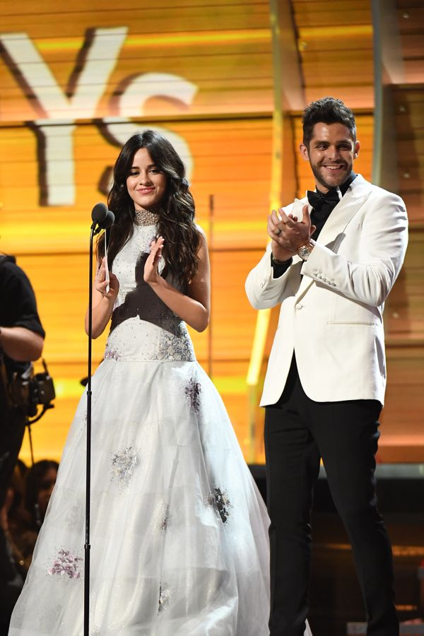 Recording artists Camila Cabello (L) and Thomas Rhett speak onstage during The 59th GRAMMY Awards at STAPLES Center on Feb. 1