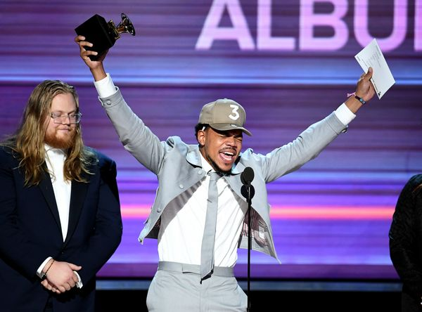 "Recording artist Chance the Rapper accepts the Best Rap Album award for ""Coloring Book"" onstage during The 59th GRAMMY Awards"