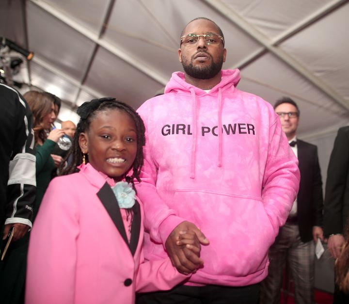 Rapper Schoolboy Q and daughter Joy Hanley at the 59th Grammy Awards.