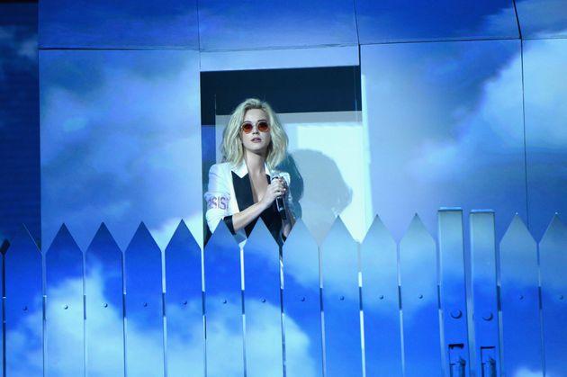 Katy behind her white picket