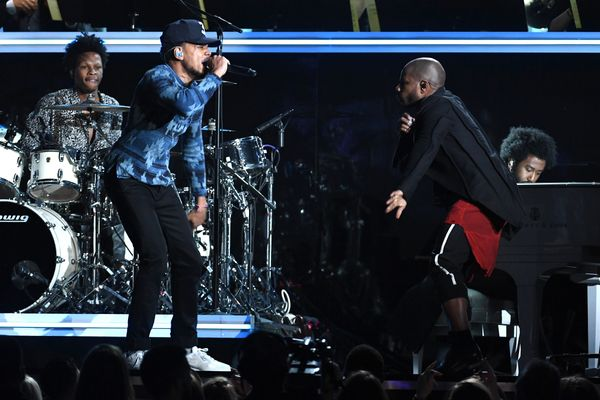 Recording artists Chance The Rapper (L) and Kirk Franklin perform onstage during The 59th GRAMMY Awards at STAPLES Center on