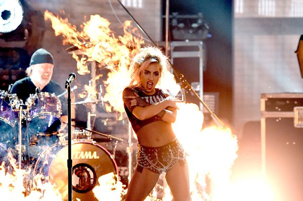 Recording artists Lars Ulrich (L) of music group Metallica and Lady Gaga perform onstage during The 59th GRAMMY Awards at STA