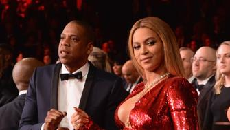 LOS ANGELES, CA - FEBRUARY 12:  Recording artists Jay Z (L) and Beyonce pose during The 59th GRAMMY Awards at STAPLES Center on February 12, 2017 in Los Angeles, California.  (Photo by Kevin Mazur/Getty Images for NARAS)