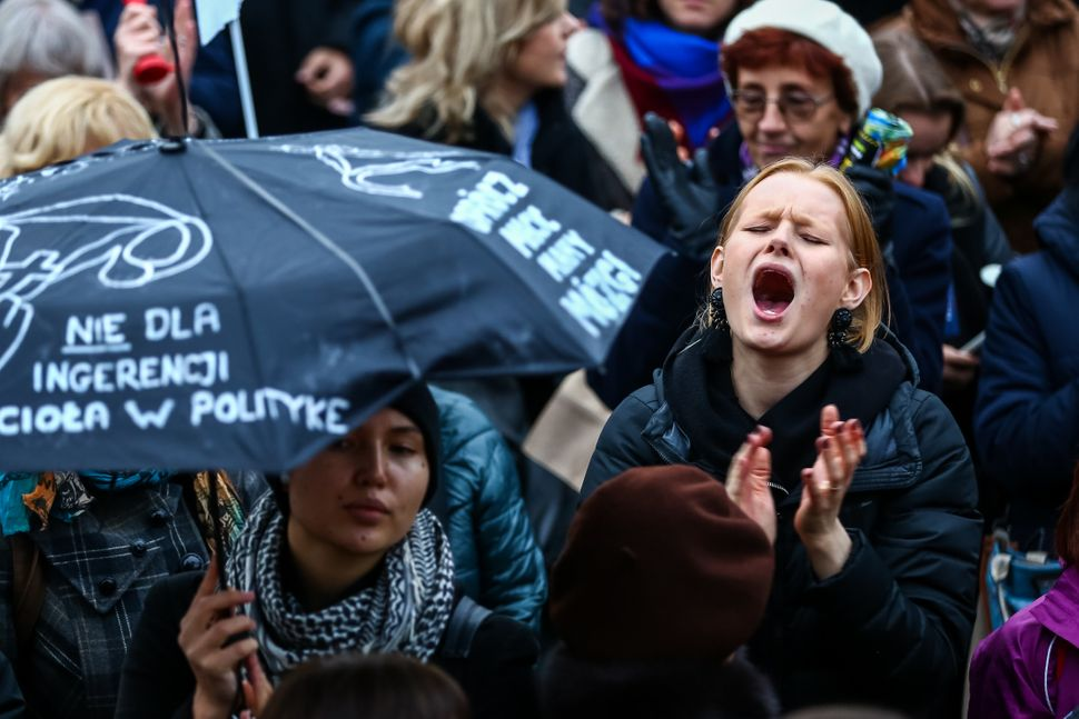 Hundreds of women with umbrellas participate in a nationwide women's strike on Oct. 24, 2016 in the city center of Warsaw, Po