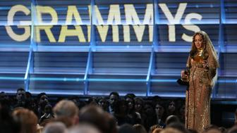 "Beyonce accepts the Grammy for Best Urban Contemporary Album for ""Lemonade"" at the 59th Annual Grammy Awards in Los Angeles, California, U.S. , February 12, 2017. REUTERS/Lucy Nicholson"