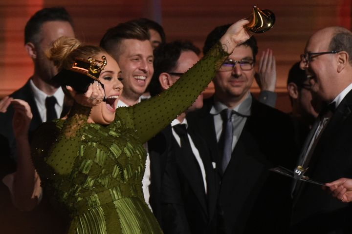 Adele's all laughs as she breaks her Grammy.