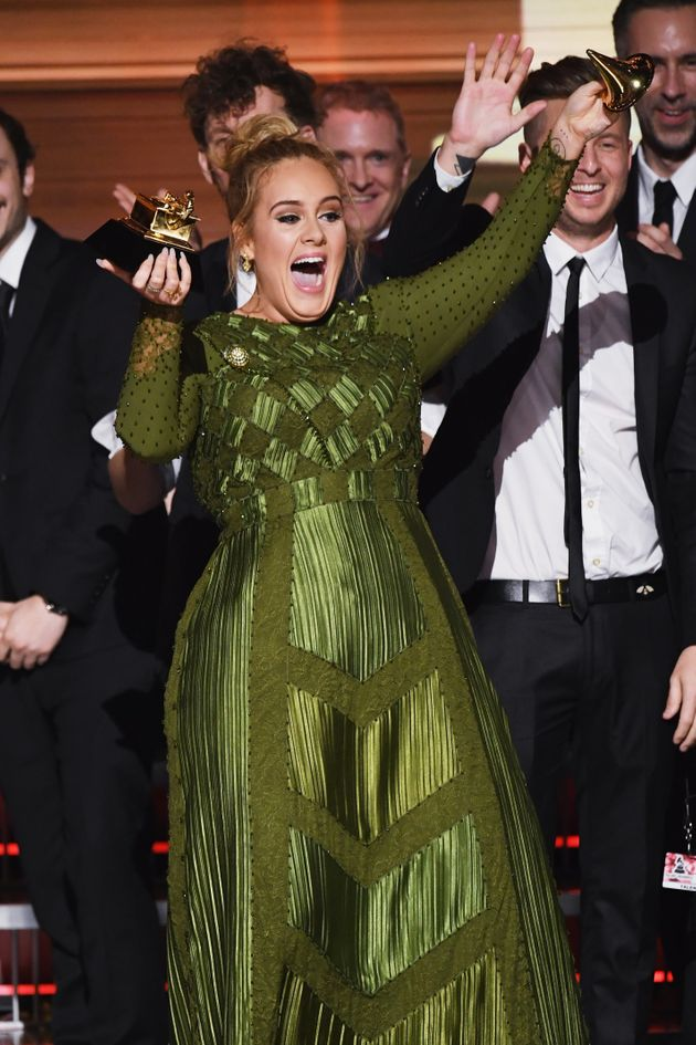 Adele purposefully breaks her Grammy so she and Beyoncé can share