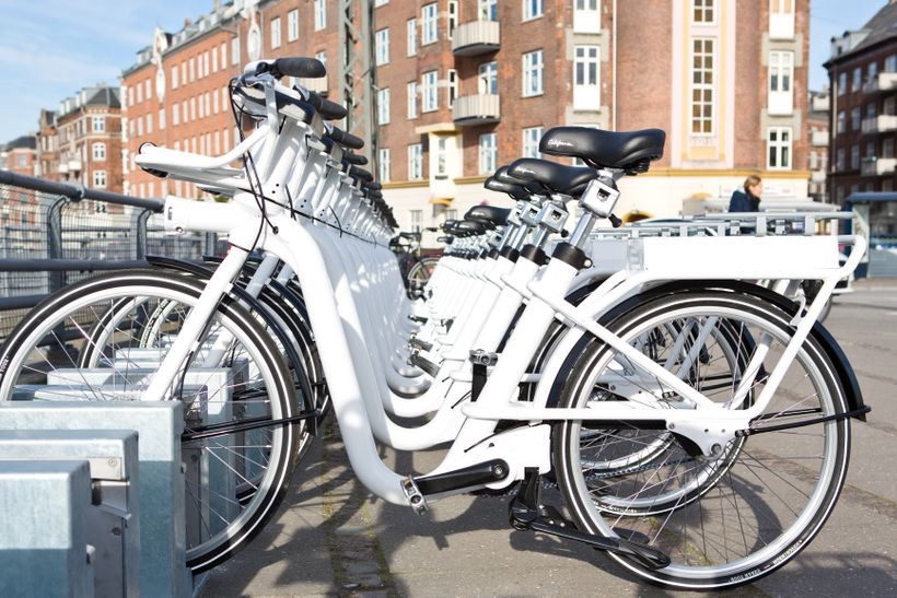Electric bikes parked in charging docks available across the city through Copenhagen's bikeshare program